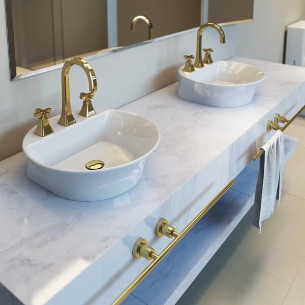 Cuba de apoio para banheiro deca e elementos em dourado trazem sofisticação ao espaç