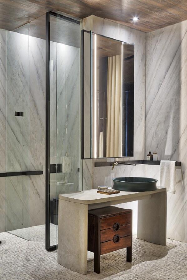 Projeto minimalista com cuba de apoio para banheiro em formato redondo