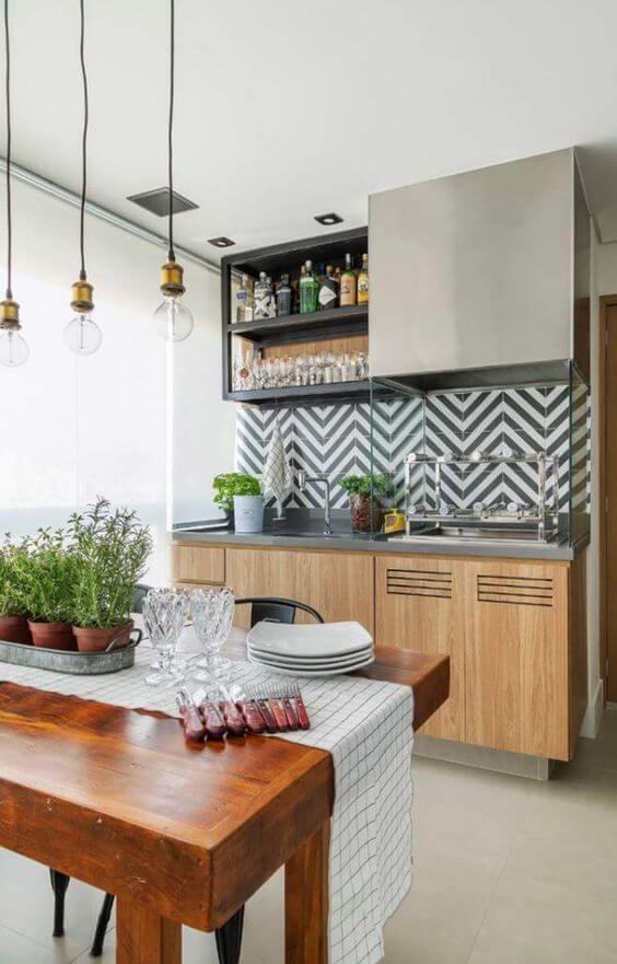 Área gourmet com revestimento geométrico