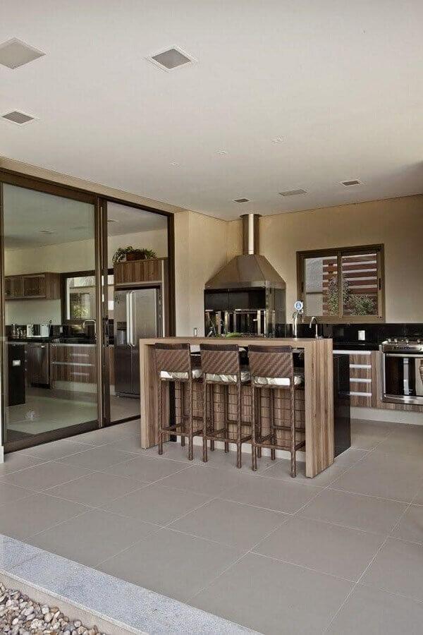 banqueta para área gourmet grande decorada com churrasqueira Foto Architecture & Design