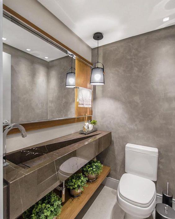 Cuba marrom no lavabo pequeno