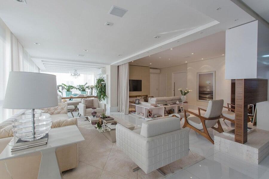 decoração de varanda de apartamento sofisticado integrada com sala de estar Foto Marcia Acaro