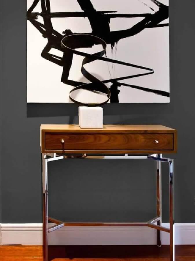 decoração moderna com quadro abstrato e aparador pequeno com gaveta Foto Pinterest