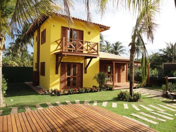 Tenha uma casa alegre com fachada amarela