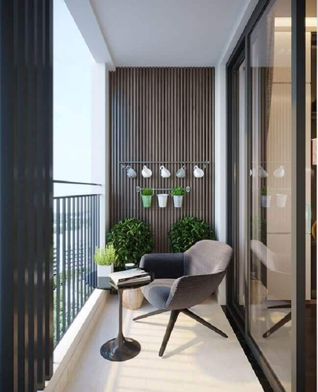 poltrona pequena para varanda moderna decorada com revestimento de madeira Foto DezignArk
