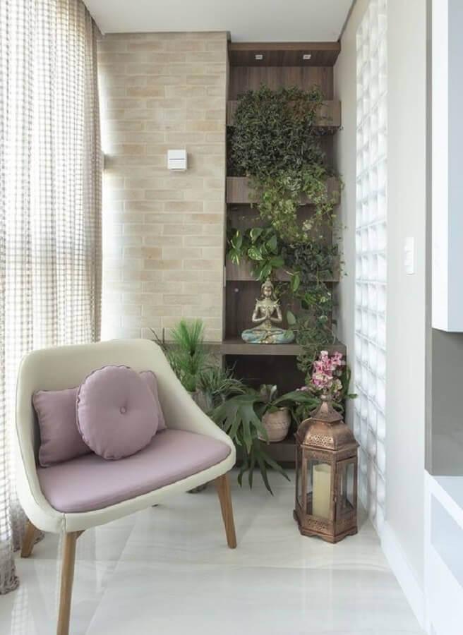 poltrona pequena para varanda planejada com jardim vertical  Foto Pinterest