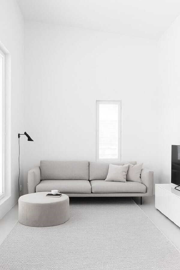 sala de estar minimalista decorada com luminária de parede Foto Pinterest