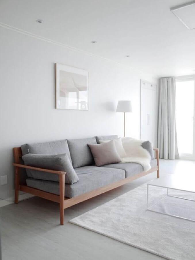 sala minimalista branca decorada com sofá cinza de madeira Foto Futurist Architecture