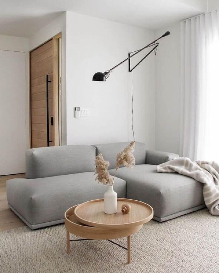 sofá moderno para decoração de sala minimalista pequena com luminária moderna Foto Behance