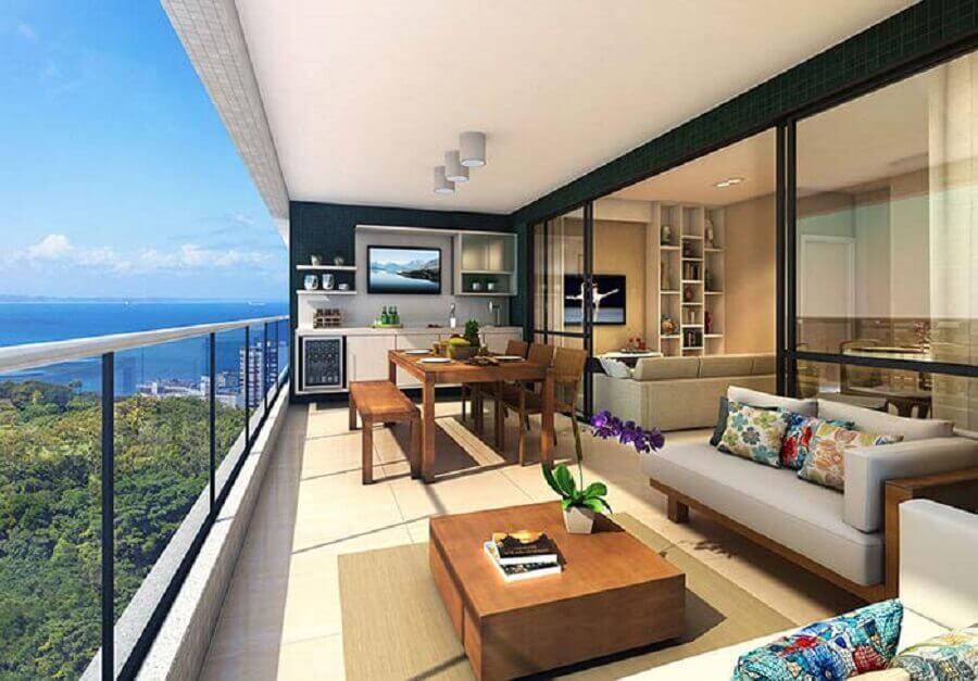 sofá moderno sem braço para decoração de varanda de apartamento com mesa e cadeiras de madeira Foto LRV Móveis