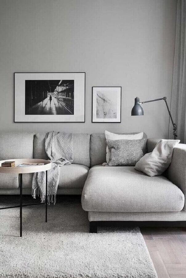 tons de cinza para decoração de sala minimalista com sofá de canto Foto Futurist Architecture