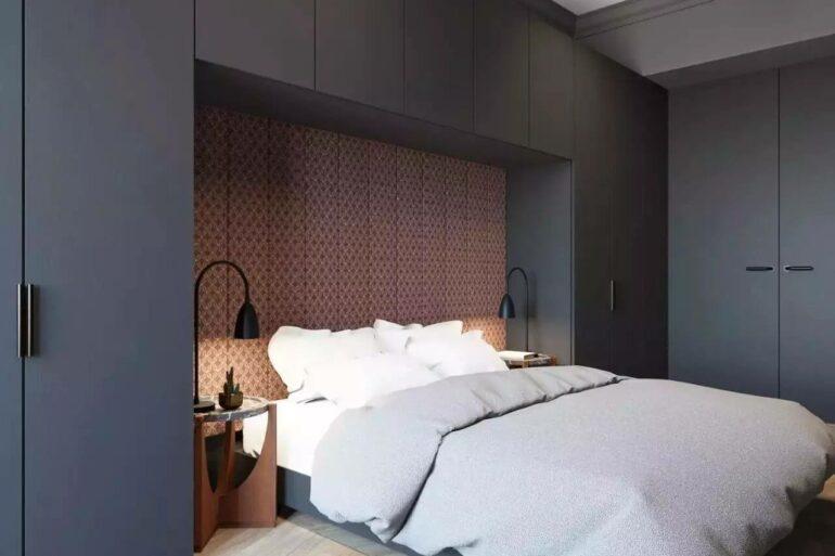 Esse modelo de guarda-roupa com cama embutida aproveita todos os espaços
