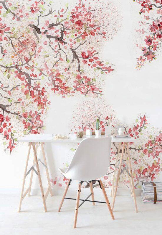 Papel de parede rosa com arvore cheia de flores