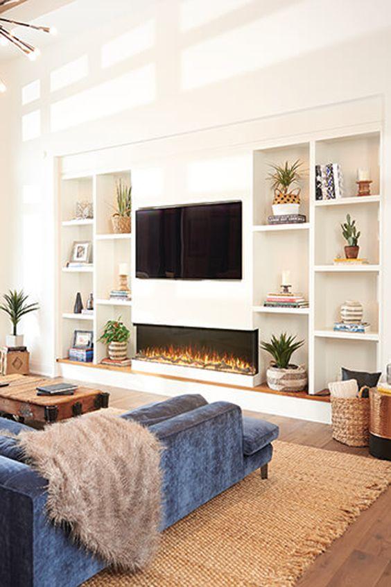Sala com estante planejada de cores neutras