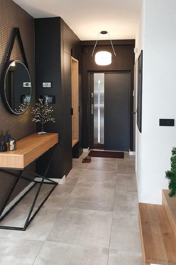 Aparador com espelho redondo para decoração de corredor preto moderno