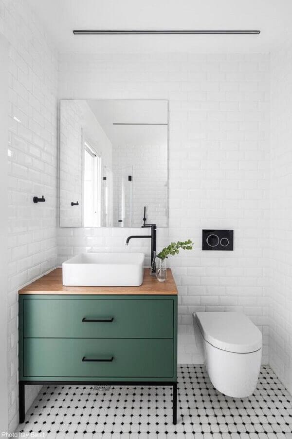 Azulejo para parede de banheiro branco decorado com gabinete verde