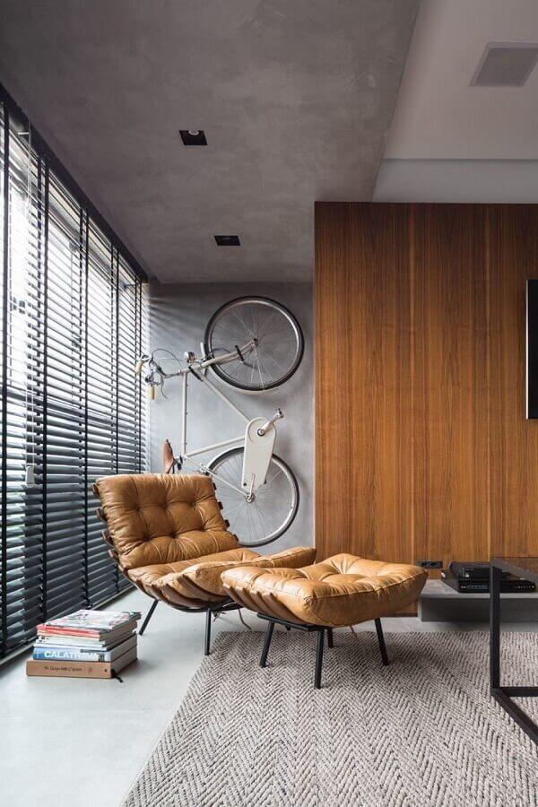 casa estilo industrial decorada com poltrona de couro marrom Foto Futurist Architecture