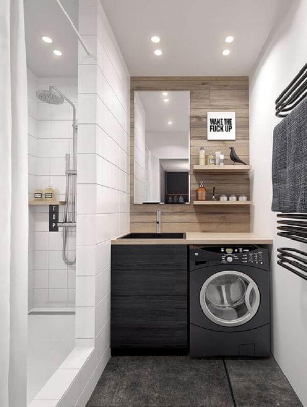 Lavanderia planejada e simples com revestimento de alvenaria
