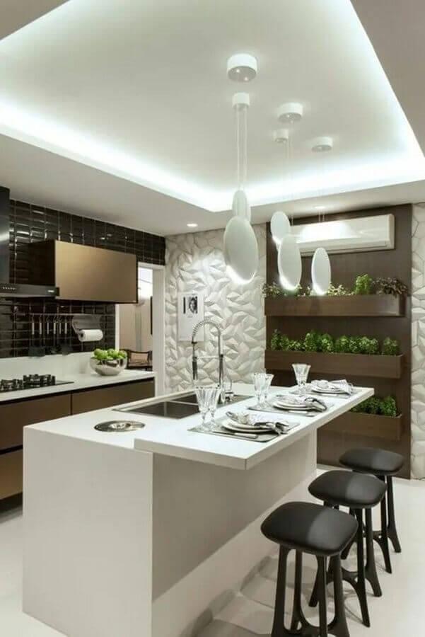 revestimento 3D para decoração de cozinha com ilha gourmet pequena Foto Archzine