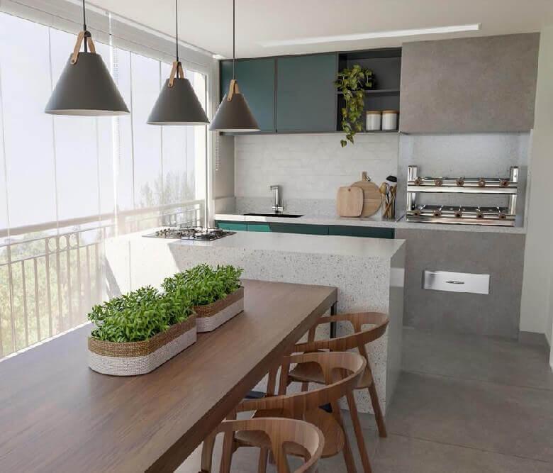 varanda de apartamento decorada com ilha gourmet com mesa e cooktop Foto Dicas de Mulher