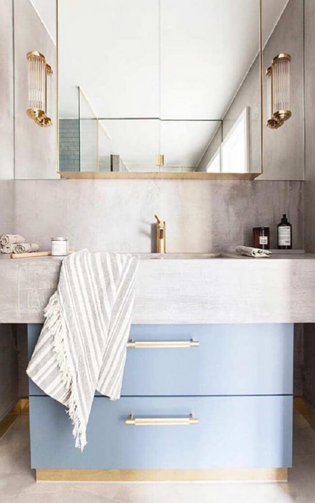 A bancada de cimento queimado e cuba juntas otimizam os espaços do banheiro. Fonte: Pinterest