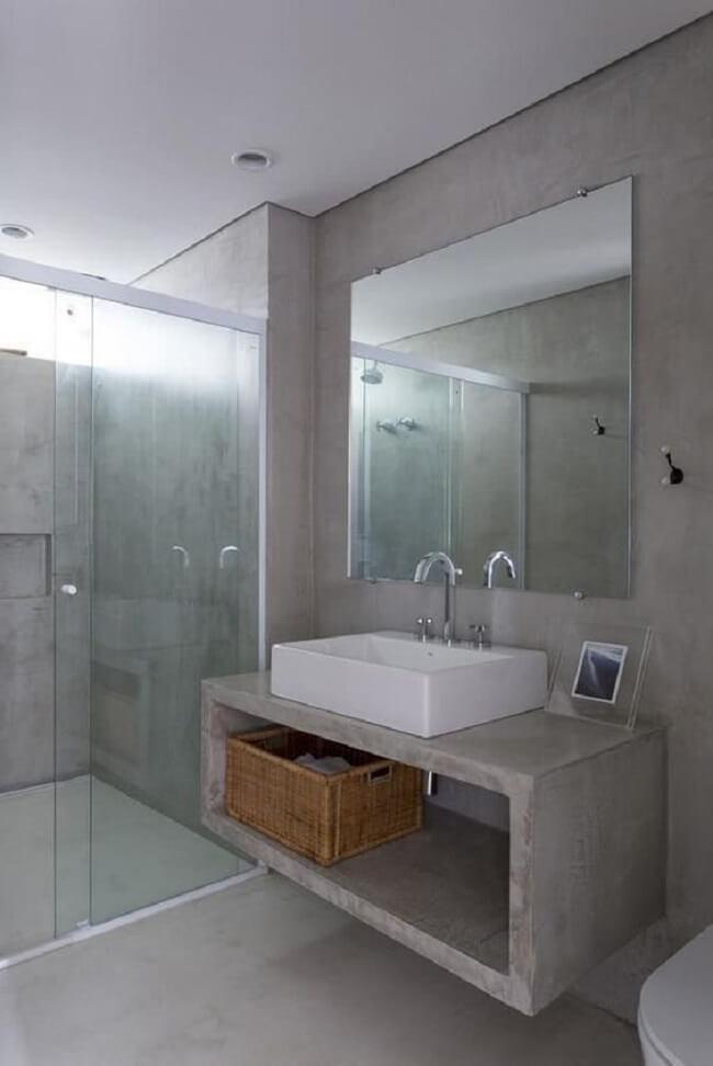 Bancada de banheiro de cimento queimado com cuba quadrada. Fonte: Felipe Hess