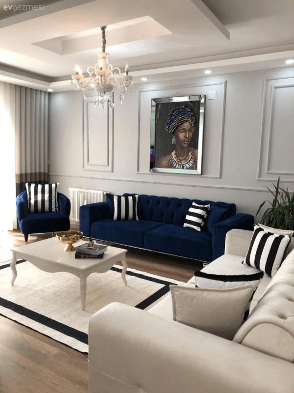 Conjunto de sofá azul marinho e poltrona da mesma cor