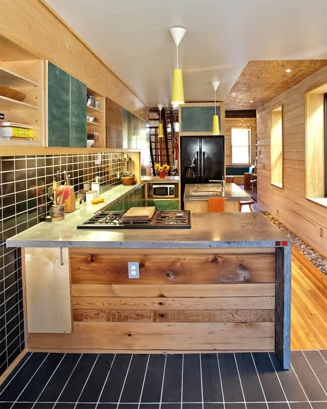 Cozinha compacta com bancada de cimento queimado. Fonte: Limaonagua