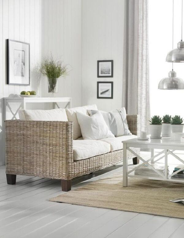 Decoração clean com sofá de vime para sala