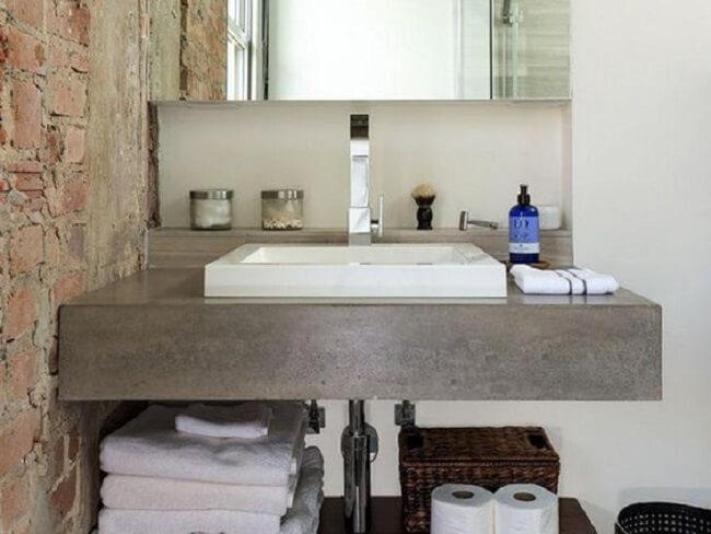 Decoração simples com bancada de banheiro de cimento queimado. Fonte: Content Architecture