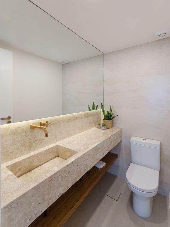 Lavabo com granito bege e espelho