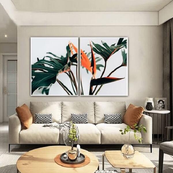 Mosaico de quadros com plantas decoram a sala. Fonte: Pinterest