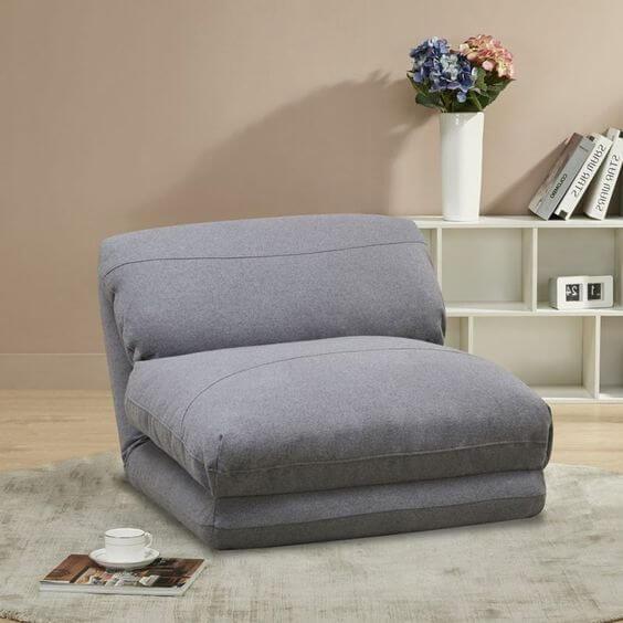 Sala aconchegante com poltrona cama