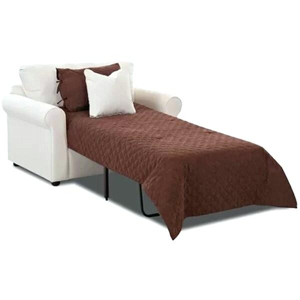 Sala com poltrona cama