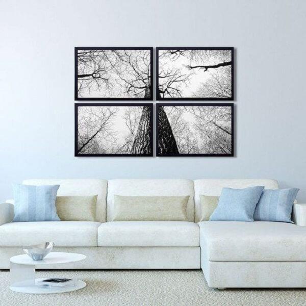 Sala de estar clean com mosaico de quadros na parede. Fonte: Pinterest