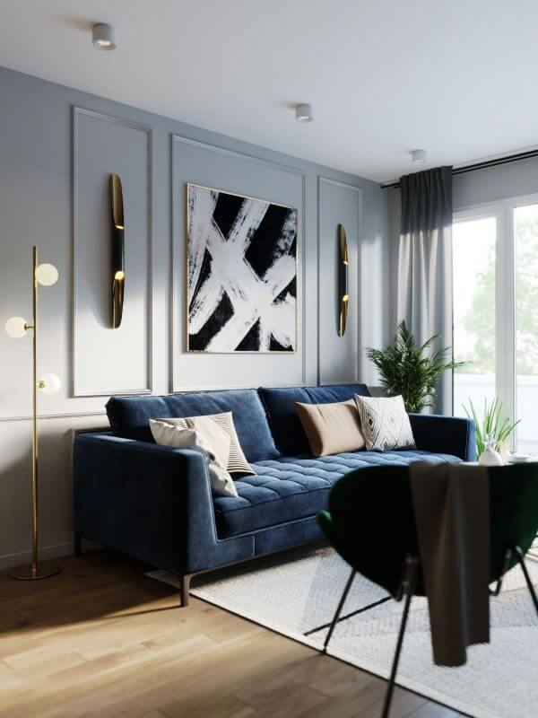 Sofá azul marinho com quadro preto e branco