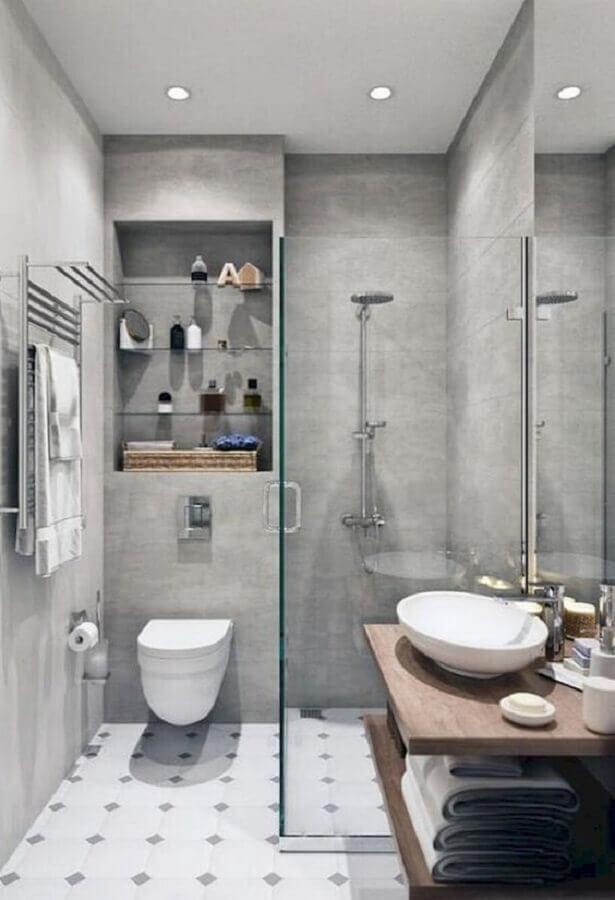 banheiro cimento queimado decorado com nicho embutido e bancada de madeira Foto Pinterest