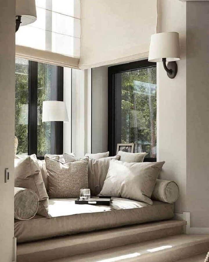 confortável cantinho de leitura decorado com luminária de parede Foto No Decora