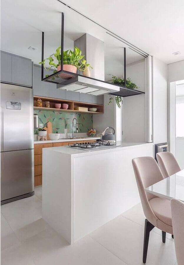 decoração clean para cozinha planejada com balcão com cooktop Foto Duda Senna