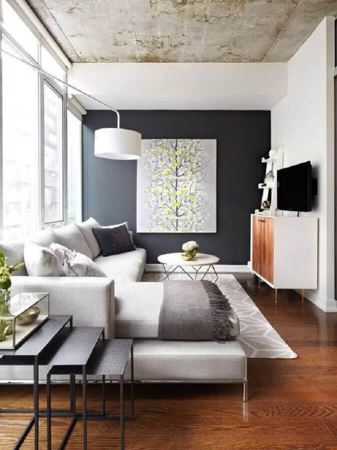 decoração de sala com sofá grande e mesa de centro redonda moderna  Foto Pinterest