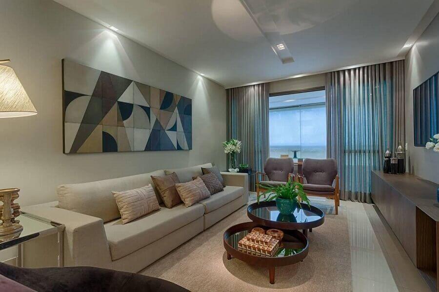 decoração em cores claras com quadros decorativos grandes para sala Foto Jeito de Casa