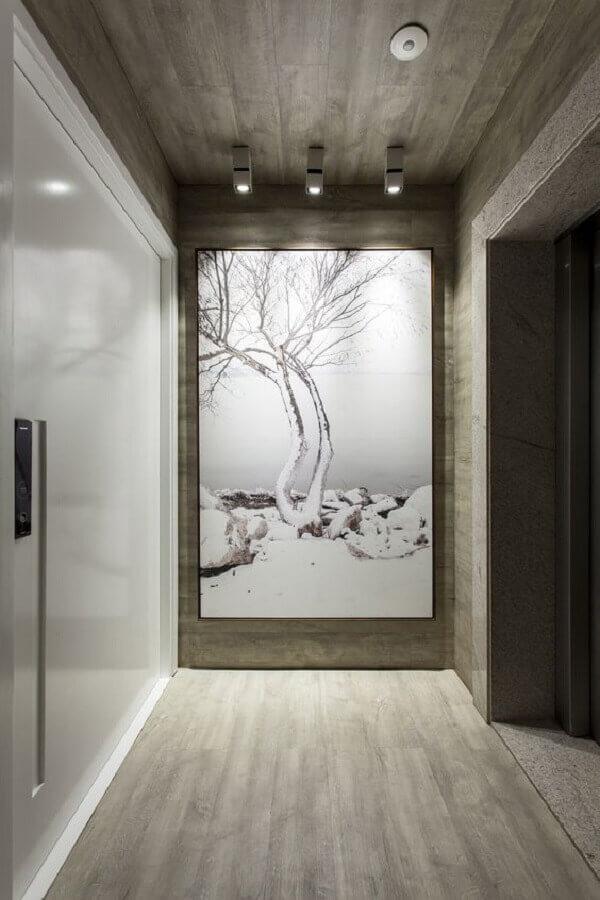 decoração moderna para hall de entrada com quadro grande Foto Pires e Medeiros Arquitetura
