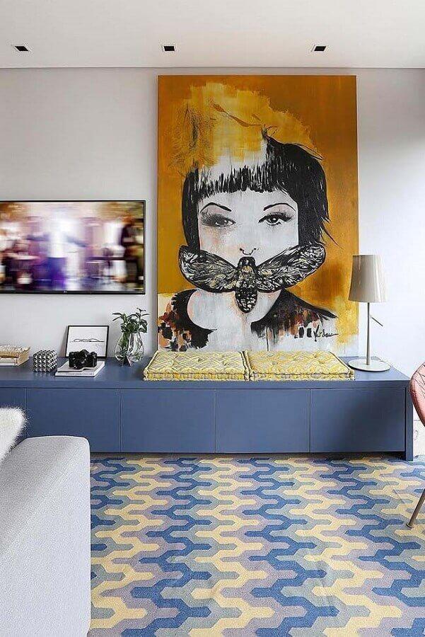quadro grande apoiado em rack azul para decoração de sala de TV Foto Architecture Art Designs