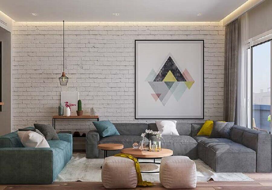 quadro grande para sala de estar decorada com parede de tijolinho branco Foto Pinterest