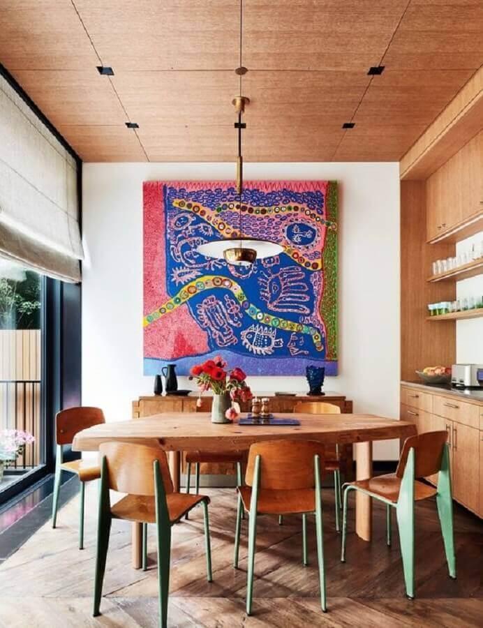 quadros grandes para sala de jantar decorada com móveis de madeira Foto Pires e Medeiros Arquitetura