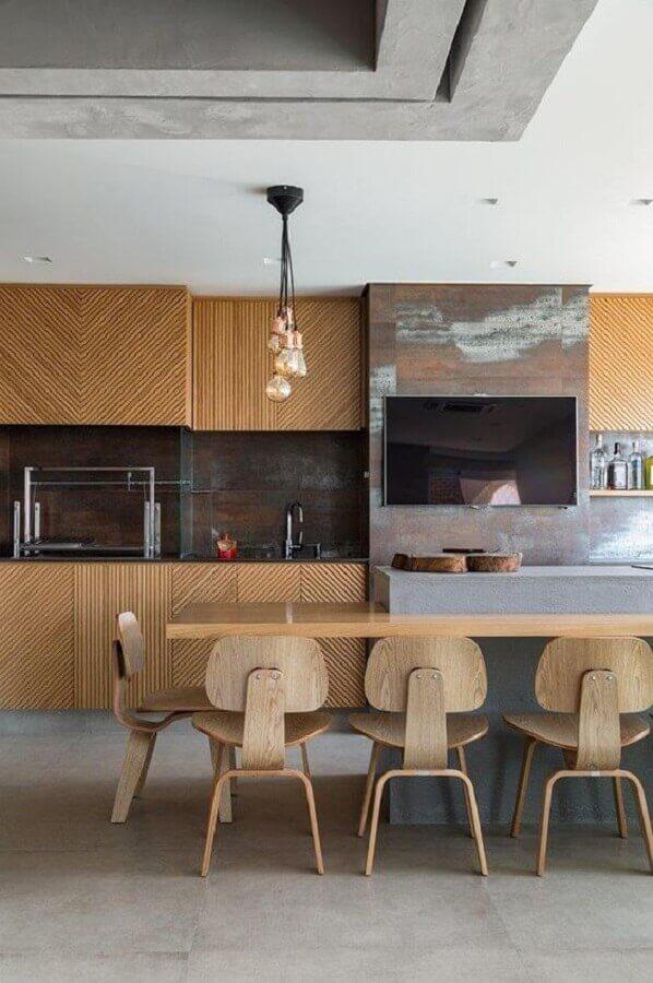 revestimento de madeira para área gourmet moderna com churrasqueira e ilha de concreto Foto Home Fashion Trend
