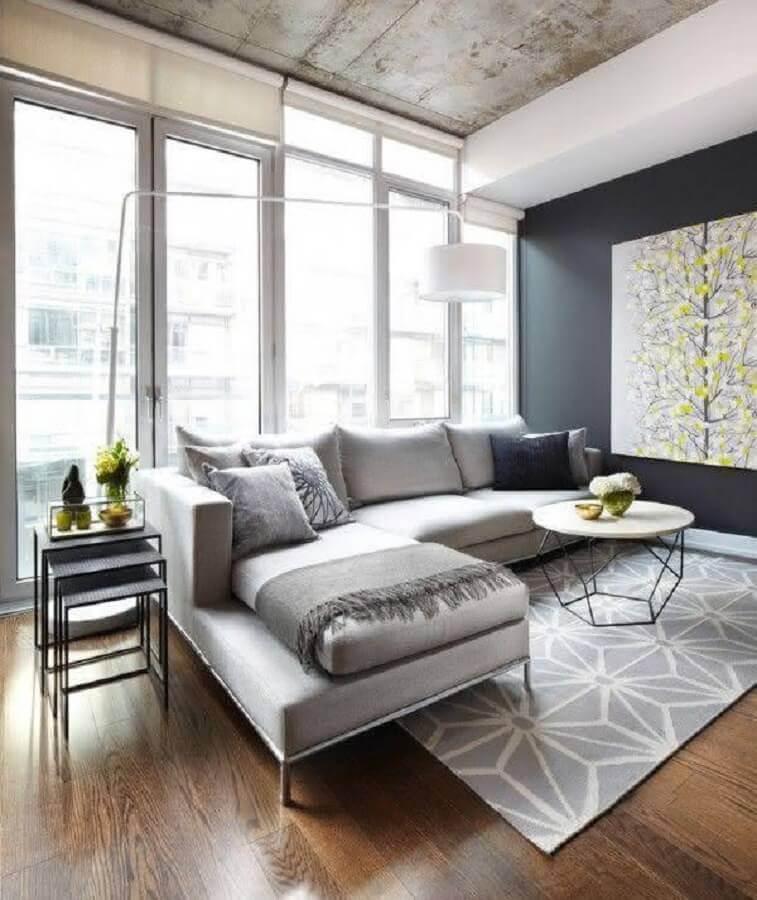 sala moderna decorada com mesa de centro redonda e sofá com chaise Foto Home Fashion Trend