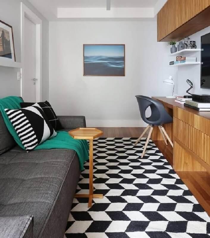 sala pequena decorada com modelo de tapete geométrico preto e branco Foto ACF Arquitetura