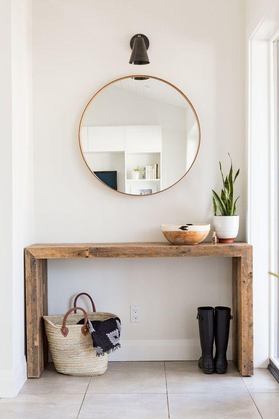 Aparador rustico com espelho redondo dourado