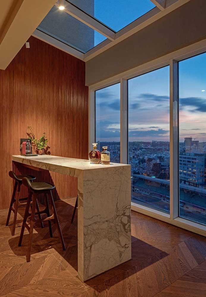 Área gourmet com varanda de vidro